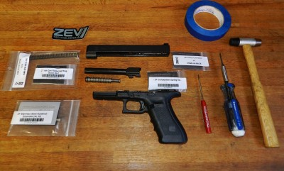 Field stripping a Gen4 Glock 34 for upgraded springs and Gen3 recoil system parts.