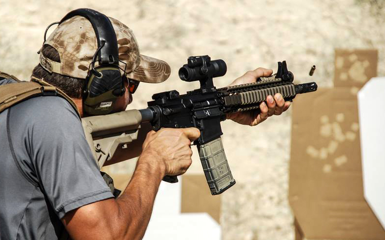 Aimpoint mounted to a SWAT entry rifle. The RDO's speed, versatility, and durability have made it a staple on the police rifle.