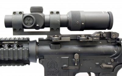 US Optics SR4C mounted on issued patrol rifle using a Larue Tactical SPR-E QD mount. The SR4C is 9.25 inches long, weighs 1.24 pounds, and has an eye relief of 3.7 inches.