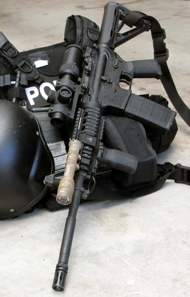 SR4C mounted on issued patrol rifle with issued plate carrier and ballistic helmet. The optic's eye box was large enough on 1x to accommodate the extra personal protective equipment without issue.